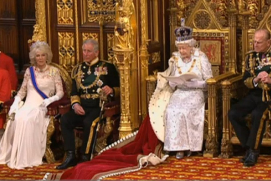 Charles and Camilla (l) seated during Queen's Speech