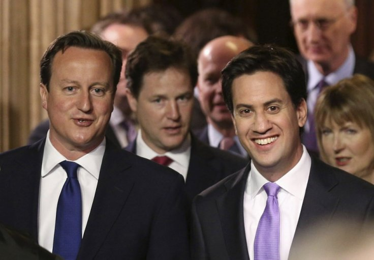 PM Cameron (l) and Labour leader Ed Miliband walk from the Commons to the House of Lords