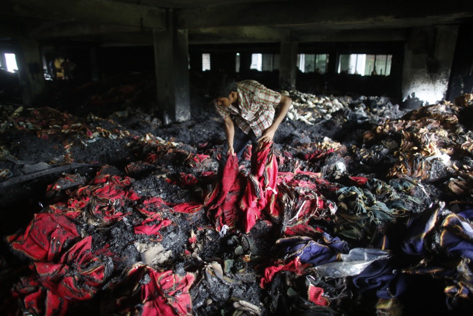 A garment worker inspects a factory belonging to Tung Hai Group,