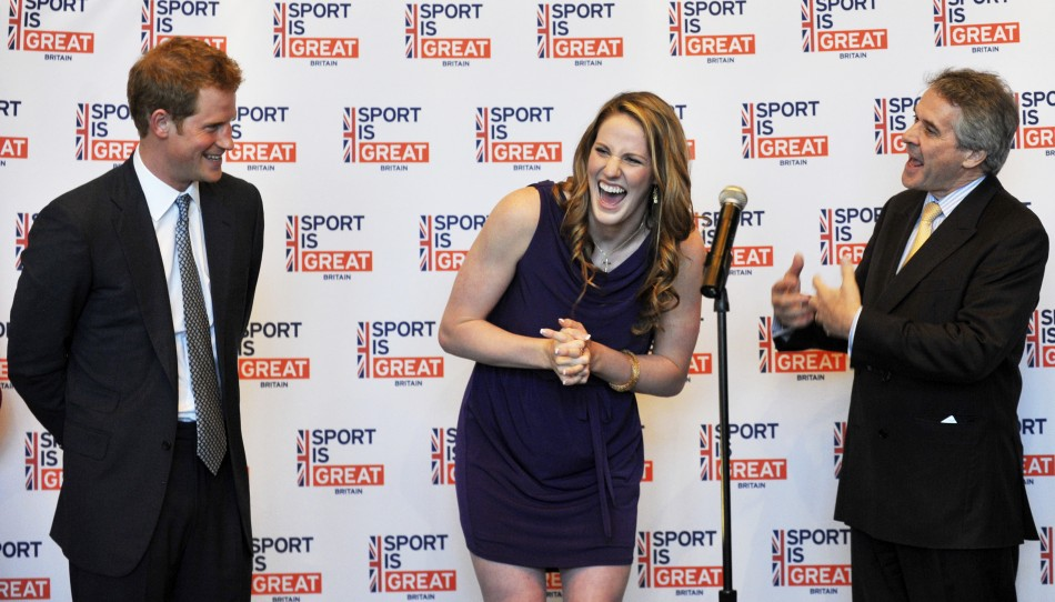 Britain's Prince Harry (L), and British Ambassador Peter Westmacott (R), celebrate the 18th birthday of Olympic gold medal swimmer Missy Franklin during a reception at the Sanctuary Golf Course in Sedalia, Colorado May 10, 2013.