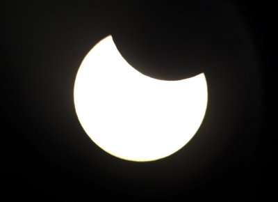 The annular solar eclipse can be seen through the viewfinder of a telescope positioned atop Observatory Hill in Sydney May 10, 2013.