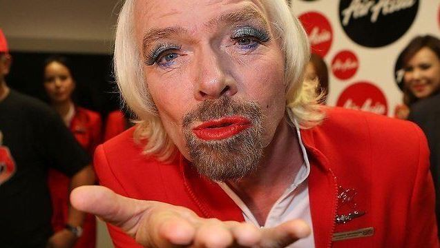 Richard Branson dresses as airline stewardess after losing F1 bet