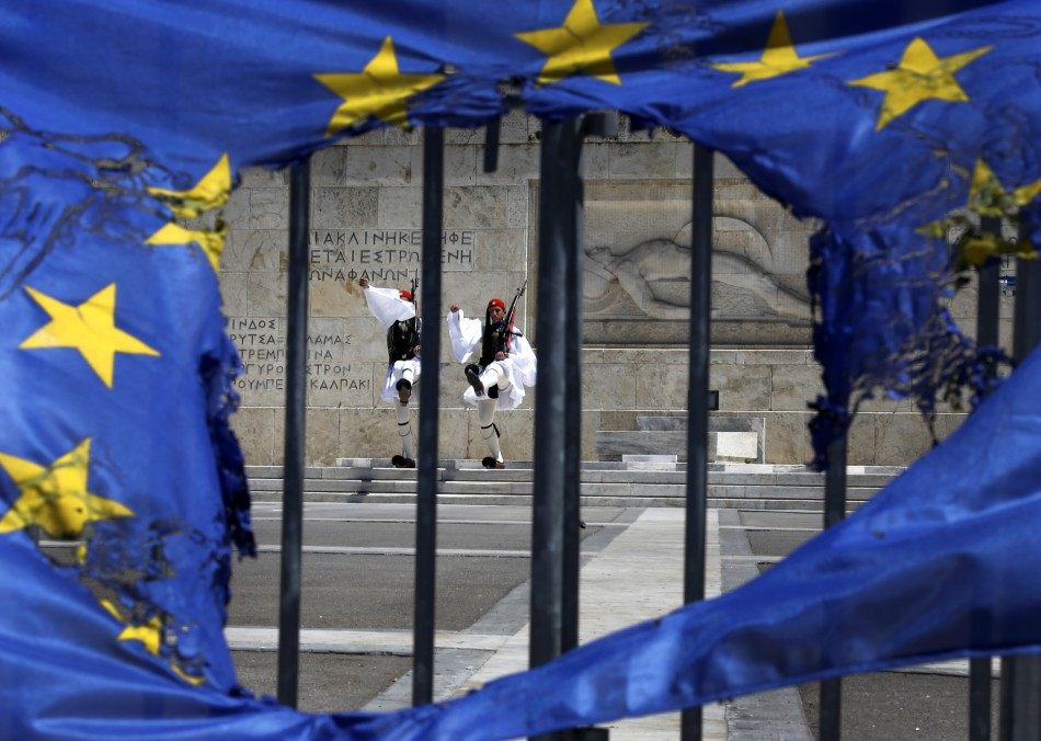 Presidential guards are framed through a burned EU flag in front of the Tomb of the Unknown Soldier by the parliament in central Syntagma square in Athens May 1, 2013 following a May Day rally. Thousands of protesters took part in the annual May Day march protesting austerity measures by the government in the debt-laden country ravaged by its sixth year of recession and popular fury over wage and spending cuts. (Photo: REUTERS)