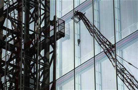 Cranes are reflected in architect Renzo Piano's partly constructed 94 storey Shard building in London