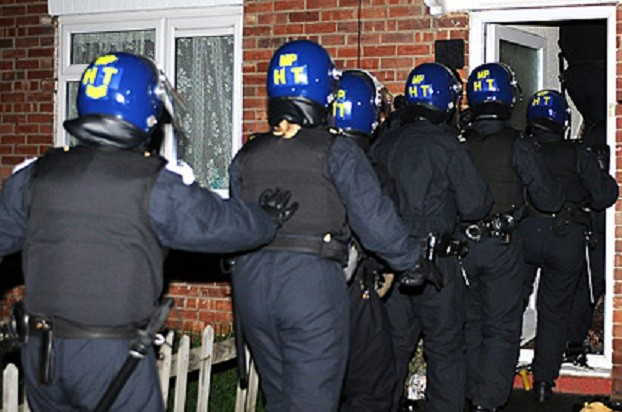 police break down door during raid