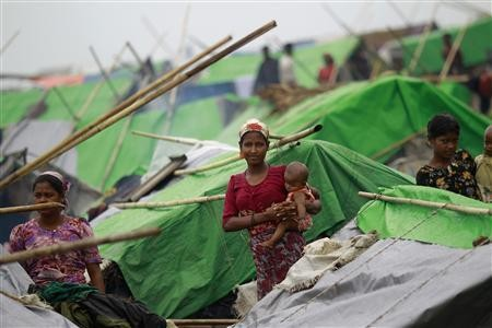 Women pass their time in a Rohingya internally displaced person (IDP) camp outside of Sittw