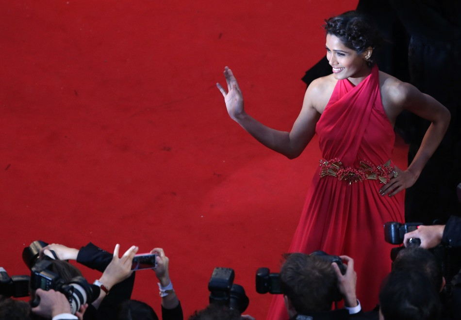 Actress Freida Pinto poses on the red carpet as she arrives for the screening of the film The Great Gatsby and for the opening ceremony of the 66th Cannes Film Festival in Cannes May 15, 2013. The Cannes Film Festival runs from May 15 to May 2