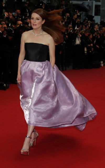 Actress Julianne Moore walks on the red carpet as she arrives for the screening of the film The Great Gatsby and for the opening ceremony of the 66th Cannes Film Festival in Cannes May 15, 2013. The Cannes Film Festival runs from May 15 to May