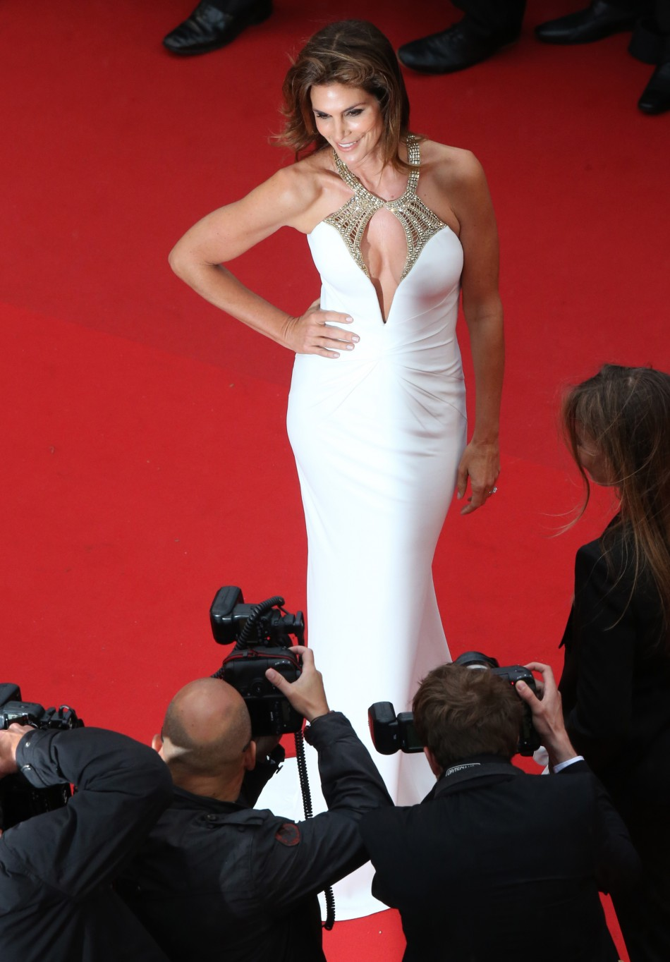 Model Cindy Crawford poses on the red carpet as she arrives for the screening of the film The Great Gatsby and for the opening ceremony of the 66th Cannes Film Festival in Cannes May 15, 2013.