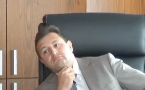 Vladimir Golubkov CEO Rosbank apparently caught in the act by Russia's Interior Ministry in a  (Photo:screengrab from the Euronews footage on YouTube)