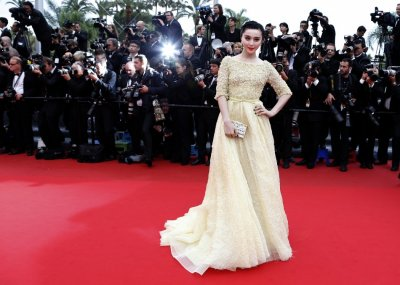 Actress Fan Bingbing poses on the red carpet as she arrives for the screening of the film Jeune  Jolie Young  Beautiful in competition during the 66th Cannes Film Festival in Cannes May 16, 2013.