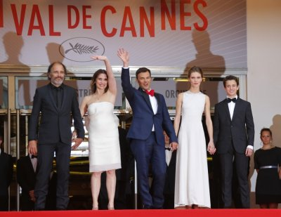 Director Francois Ozon C and cast members Frederic Pierrot L, Geraldine Pailhas 2ndL, Marine Vacth 2ndR and Fantin Ravat pose as they arrive for the screening of the film Jeune  Jolie Young  Beautiful in competition during the 66th