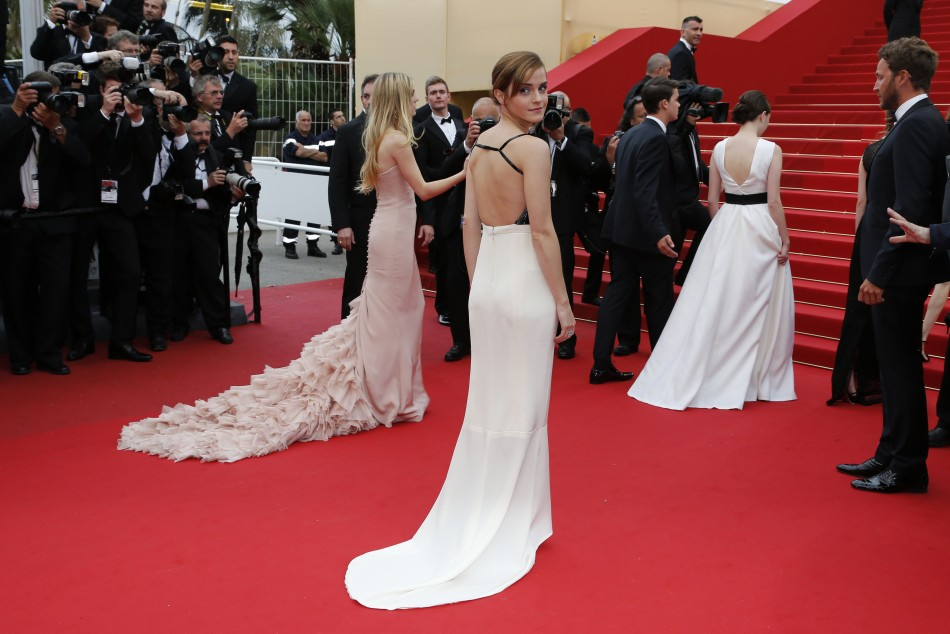 Actress Emma Watson C, cast member of the film The Bling Ring, arrives on the red carpet for the screening of the film Jeune  Jolie Young  Beautiful in competition during the 66th Cannes Film Festival in Cannes May 16, 2013