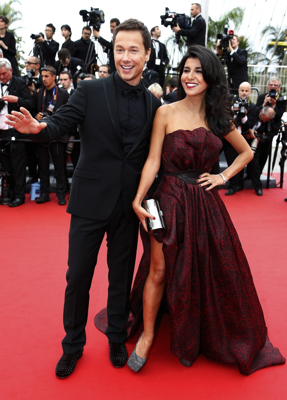 Actor Stephane Rousseau L and actress and director Reem Kherici pose on the red carpet for the screening of the film Jeune  Jolie Young  Beautiful in competition during the 66th Cannes Film Festival in Cannes May 16, 2013.