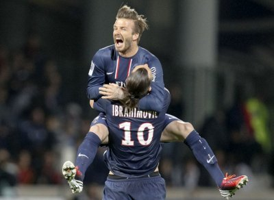Paris Saint-Germains Zlatan Ibrahimovic and David Beckham celebrate at the end of their teams French Ligue 1 soccer match against Olympique Lyon at the Gerland stadium in Lyon May 12, 2013.