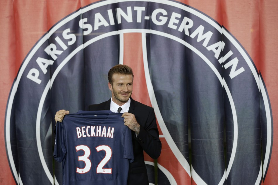 Soccer player David Beckham presents his new jersey after a news conference in Paris January 31, 2013.