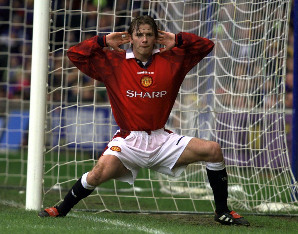 Manchester Uniteds David Beckham encourages the crowd to cheer after he scored the opening goal against Chelsea during their match at Stamford Bridge January 4 1998.