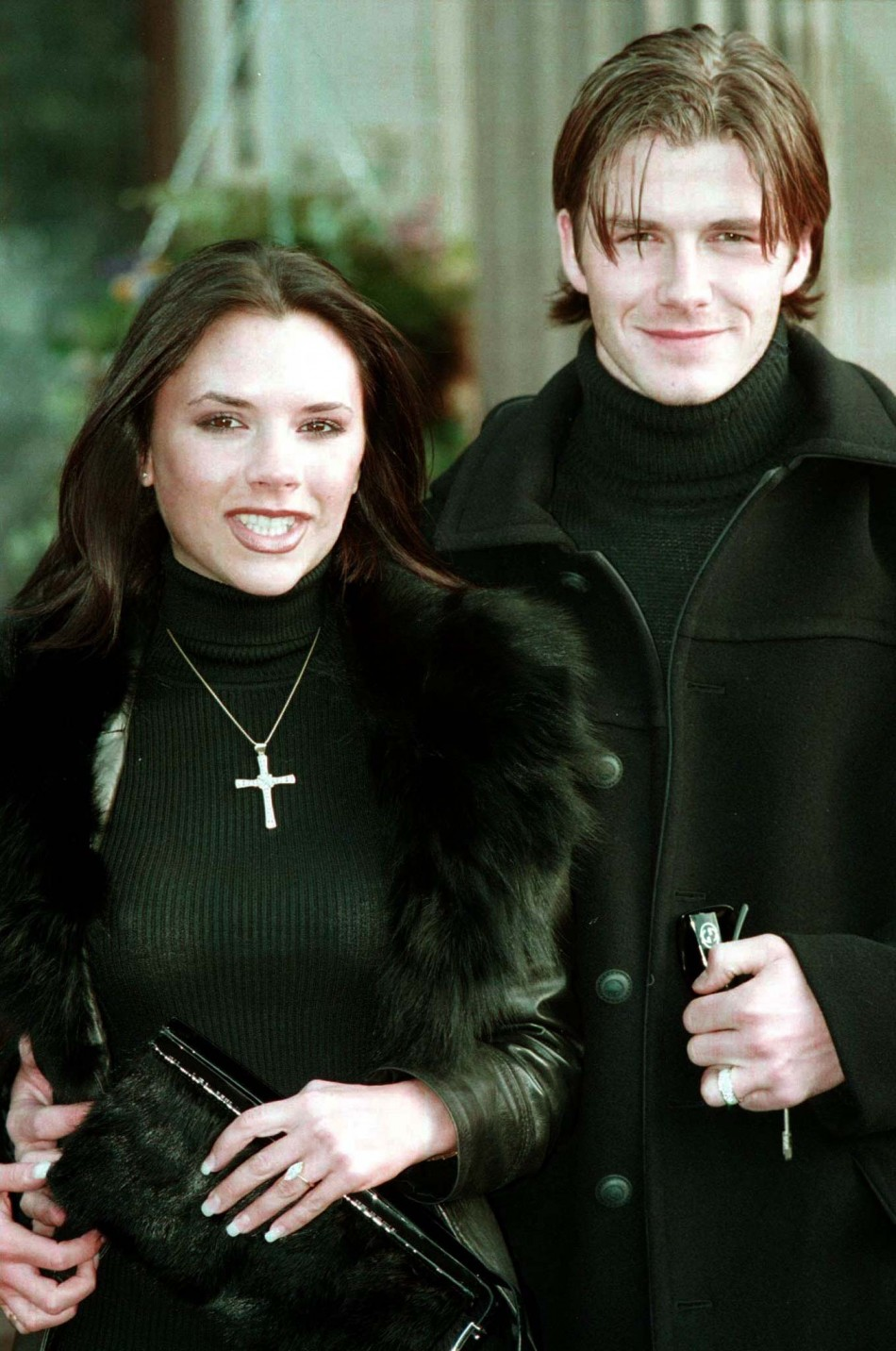Victoria Adams, then a member of the British band The Spice Girls, poses for photographers with her fiancee, Manchester United footballer David Beckham January 25 1998. Beckham and Adams made their engagement public at a luxury hotel after media speculati