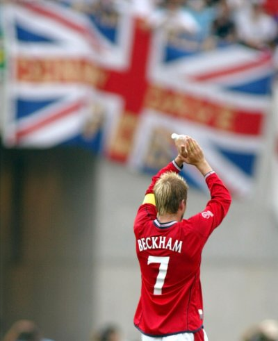 David Beckham acknowledges supporters as he walks off the pitch after the World Cup Finals group F match against Nigeria in Osaka June 12, 2002.
