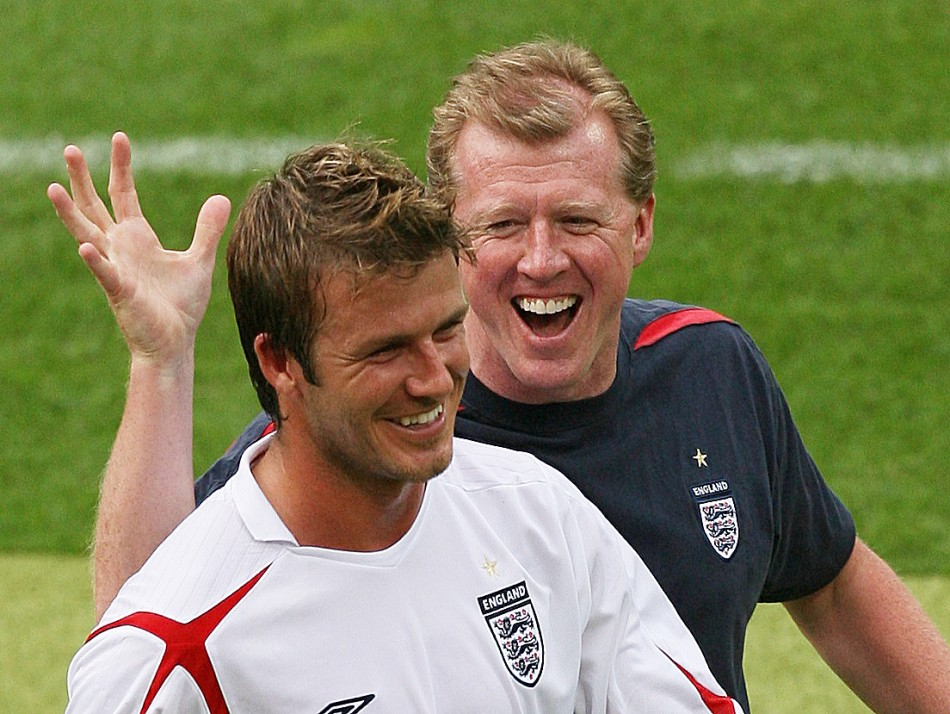 David Beckham L and assistant coach Steve McClaren celebrate after England defeated Trinidad and Tobago in their Group B World Cup 2006 soccer match in Nuremberg June 15, 2006.