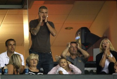 David Beckham standing reacts as his team misses a scoring chance while watching the team play their SuperLiga tournament friendly match against CF Pachuca from a private box in Carson, California July 24, 2007.