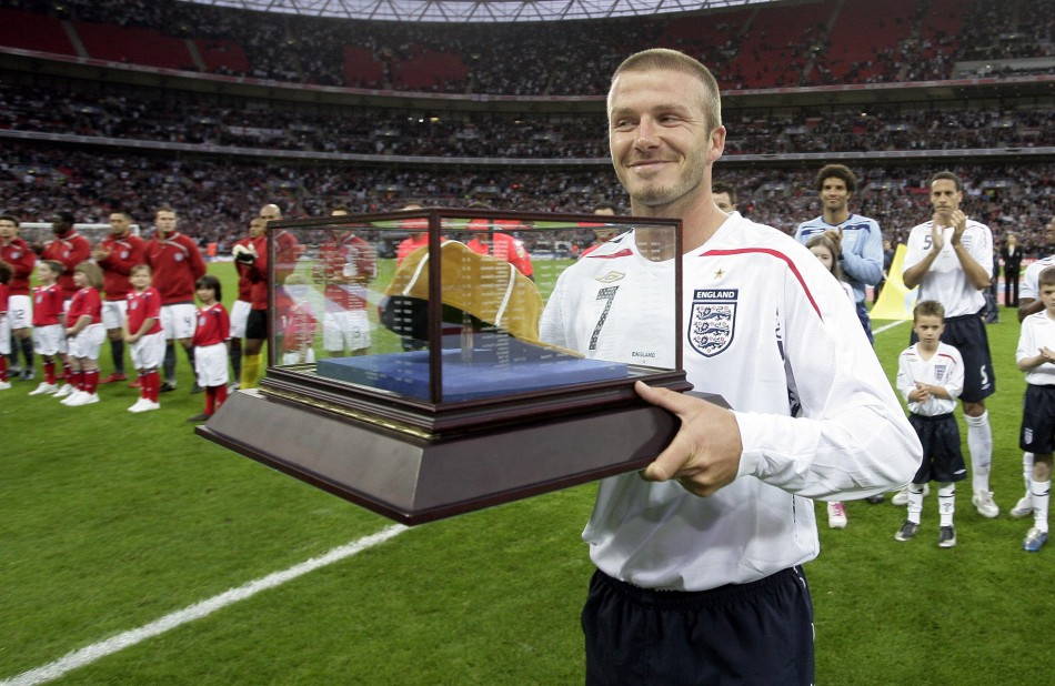 David Beckham smiles after receiving his 100th cap before the teams international friendly soccer match against the U.S. at Wembley Stadium in London May 28, 2008.
