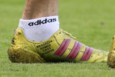 David Beckham of Britain displays the names of his four children on his boot during their MLS soccer match against the San Jose Earthquakes in Carson, California August 20, 2011.