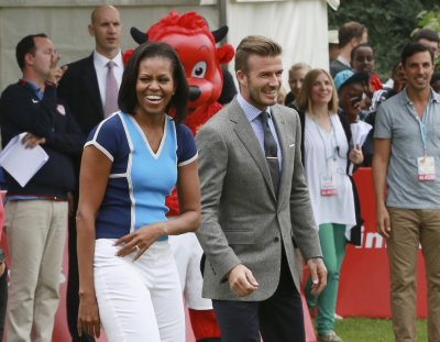 U.S. first lady Michelle Obama stands next to British footballer David Beckham during an event at the U.S. embassy in central London July 27, 2012.