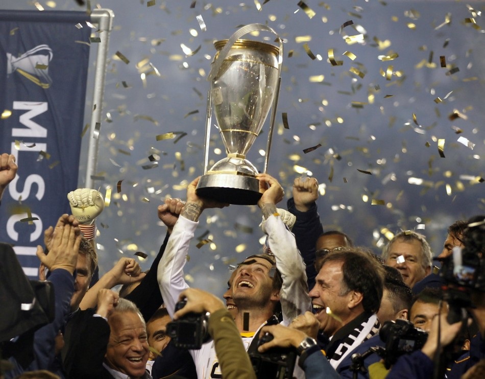 David Beckham hoists the championship trophy as the team celebrate their victory over the Houston Dynamo during their MLS Cup soccer final match in Carson, California, November 20, 2011.