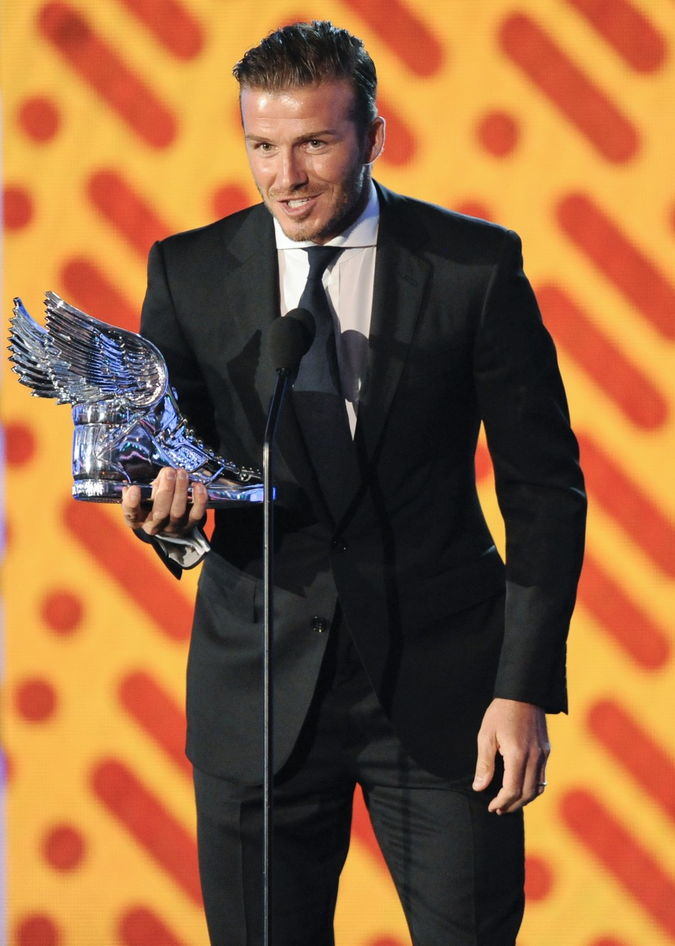 David Beckham accepts the Do Something Athlete award during the Do Something Awards in Los Angeles, California August 14, 2011.