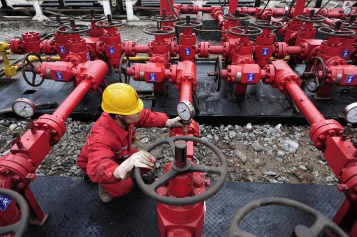 A worker performs a routine check to the valves at a natural gas appraisal well of Sinopec in Langzhong county, Sichuan province March 1, 2011. China, which has by far the world?s largest shale deposits, has just started to exploit this source of unconven
