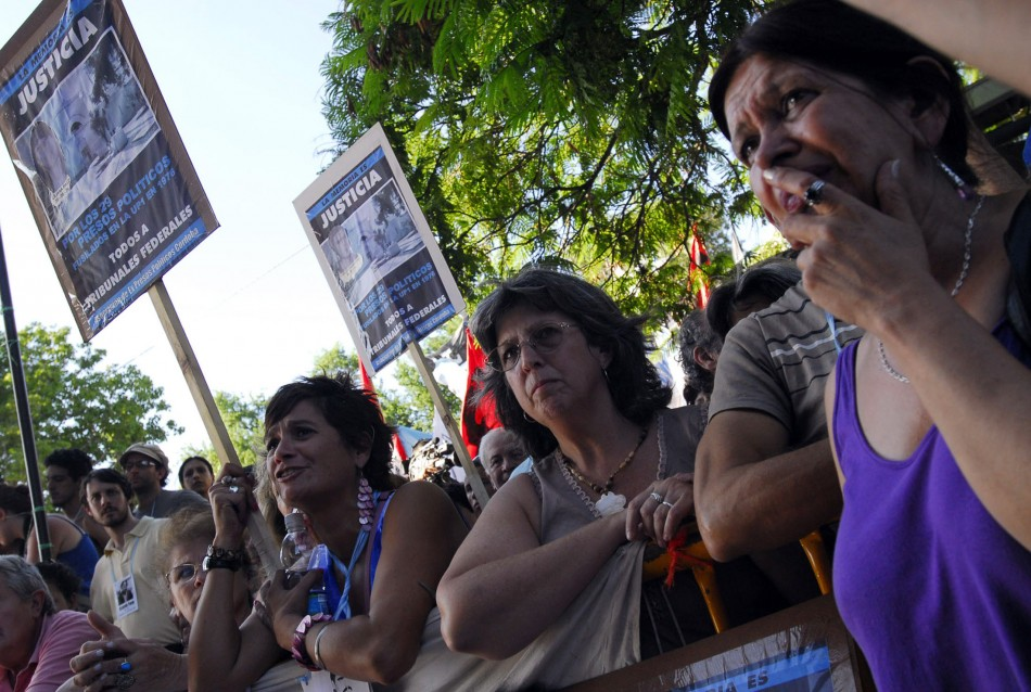 People await the verdict on the trial of former Argentine dictator Jorge Videla outside a courthouse in the province of Cordoba,