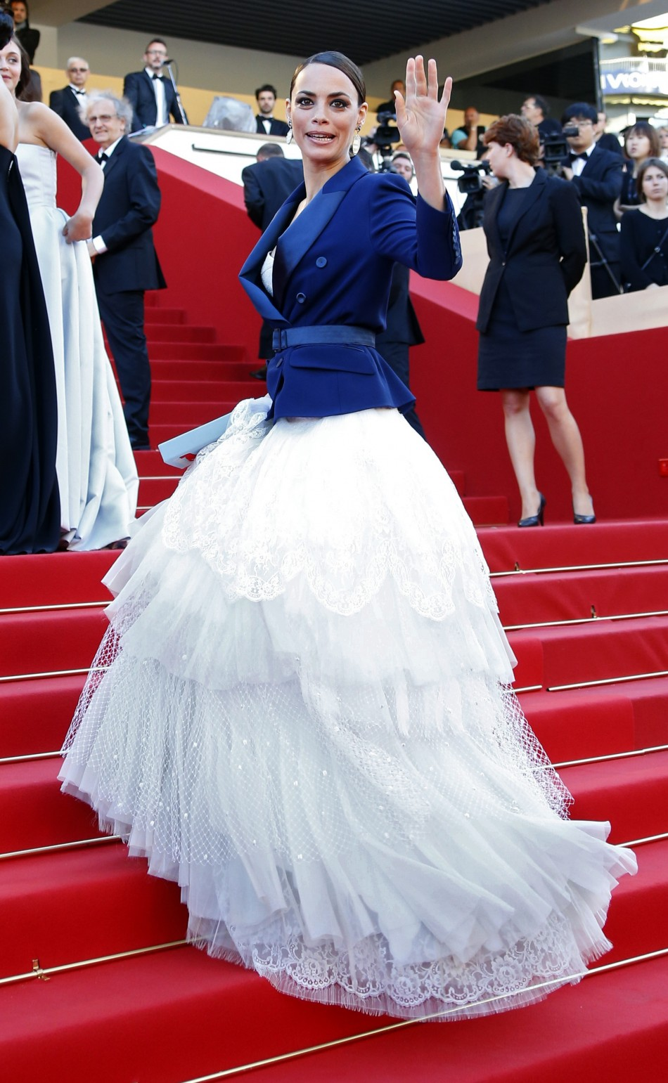 Cast member Berenice Bejo poses on the red carpet as she arrives for the screening of the film 'Le Passe' (The Past) in competition during the 66th Cannes Film Festival in Cannes May 17, 2013.