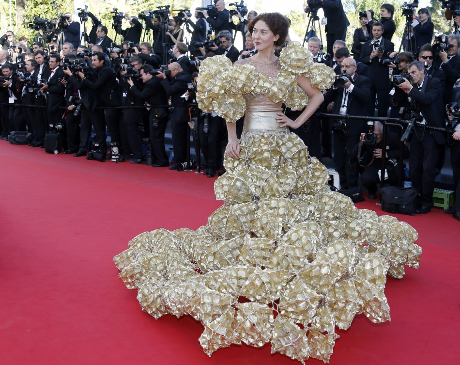 A guest poses on the red carpet as she arrives for the screening of the film 'Le Passe' (The Past) in competition during the 66th Cannes Film Festival in Cannes May 17, 2013.