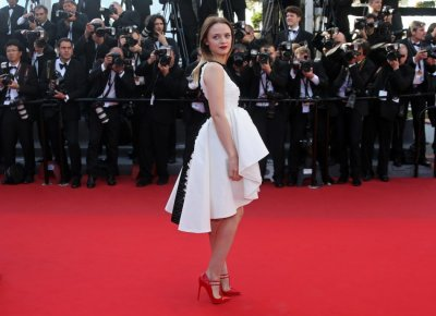 Actress Sara Forestier poses on the red carpet as she arrives for the screening of the film Le Passe The Past in competition during the 66th Cannes Film Festival in Cannes May 17, 2013.