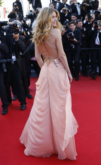 Model Doutzen Kroes poses on the red carpet as she arrives for the screening of the film Le Passe The Past in competition during the 66th Cannes Film Festival in Cannes May 17, 2013.