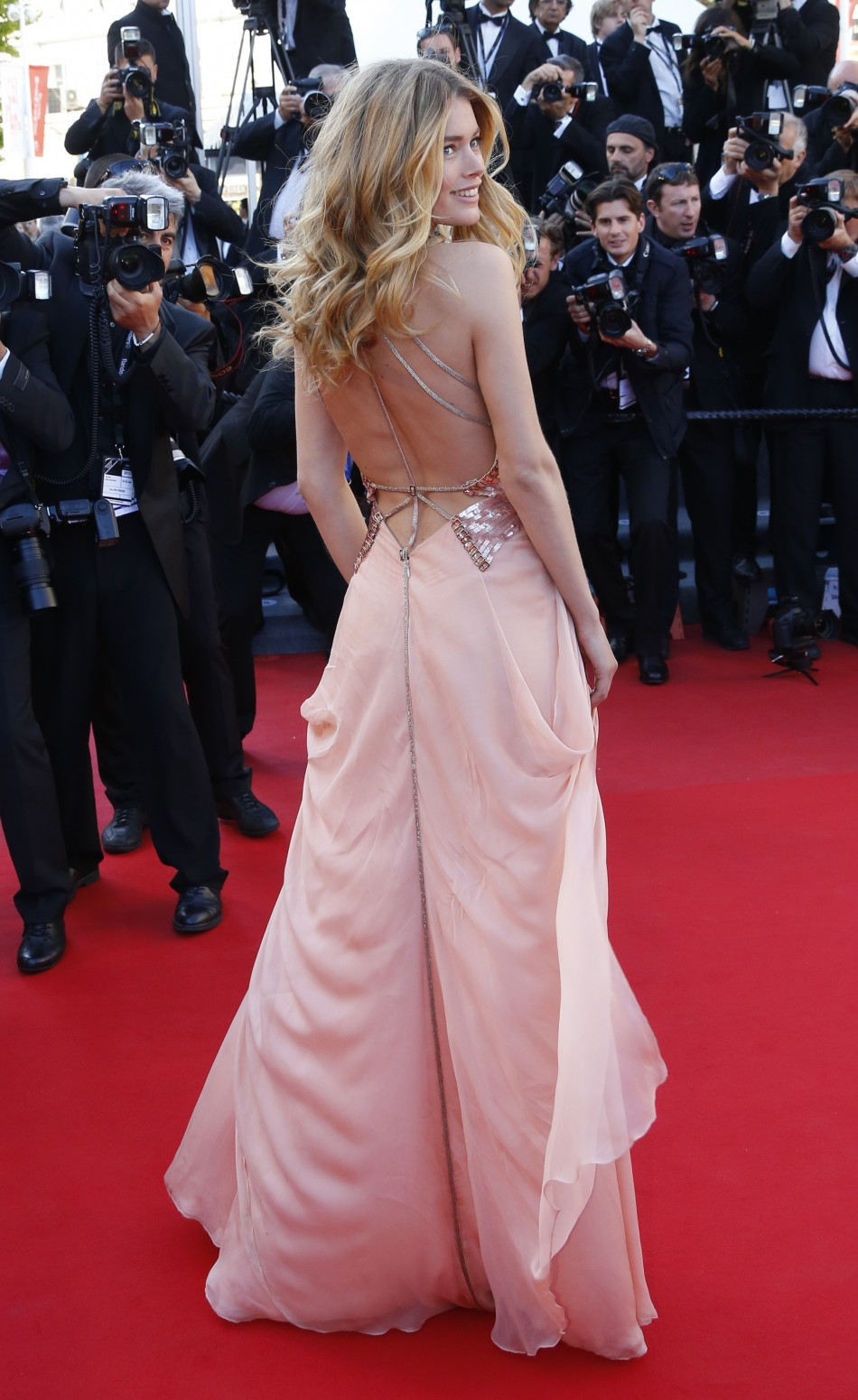 Model Doutzen Kroes poses on the red carpet as she arrives for the screening of the film 'Le Passe' (The Past) in competition during the 66th Cannes Film Festival in Cannes May 17, 2013.
