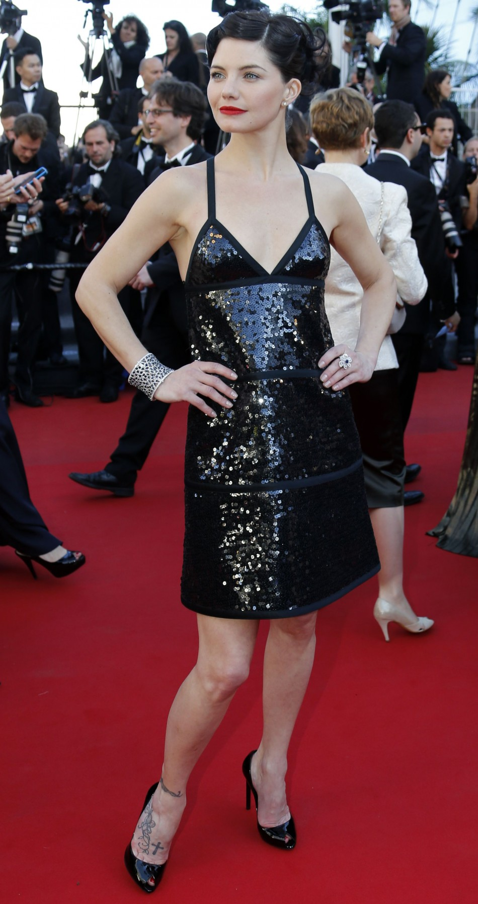 Actress Delphine Chaneac poses on the red carpet as she arrives for the screening of the film 'Le Passe' (The Past) in competition during the 66th Cannes Film Festival in Cannes May 17, 2013.