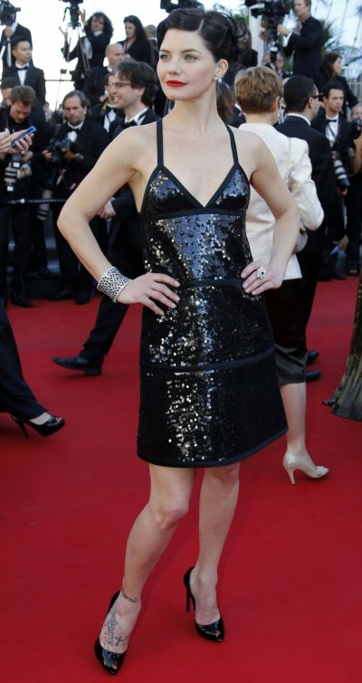 Actress Delphine Chaneac poses on the red carpet as she arrives for the screening of the film Le Passe The Past in competition during the 66th Cannes Film Festival in Cannes May 17, 2013.