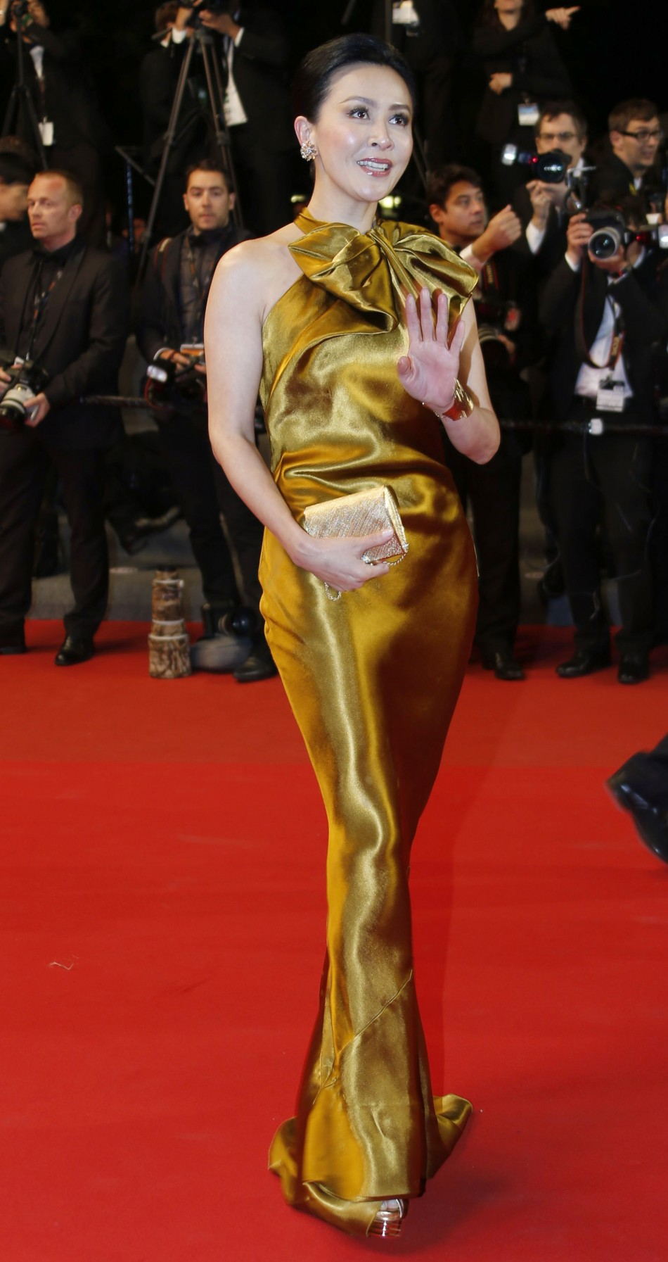 Actress Carina Lau poses on the red carpet as they for the screening of the film 'Tian Zhu Ding' (A Touch of Sin) in competition during the 66th Cannes Film Festival in Cannes May 17, 2013.