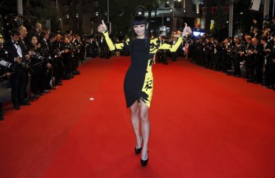 Actress Bai Ling poses on the red carpet as she arrives for the screening of the film Tian Zhu Ding A Touch of Sin in competition during the 66th Cannes Film Festival in Cannes May 17, 2013.