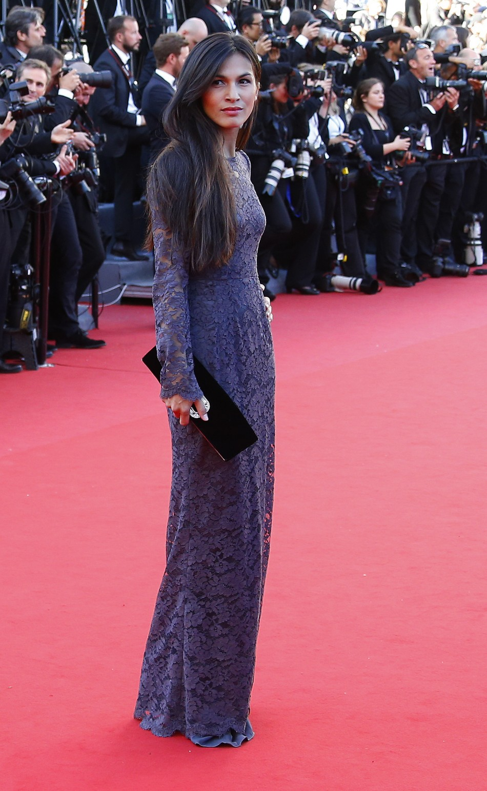 Actress Elodie Yung poses on the red carpet as she arrives for the screening of the film 'Le Passe' (The Past) in competition during the 66th Cannes Film Festival in Cannes May 17, 2013.