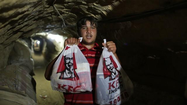 Smuggler delivering KFC through a Gazan underground tunnel