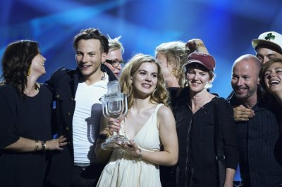 Emmelie de Forest C of Denmark celebrates holding her trophy after she won the 2013 Eurovision Song Contest with her song Only Teardrops at the Malmo Opera Hall in Malmo May 18, 2013.