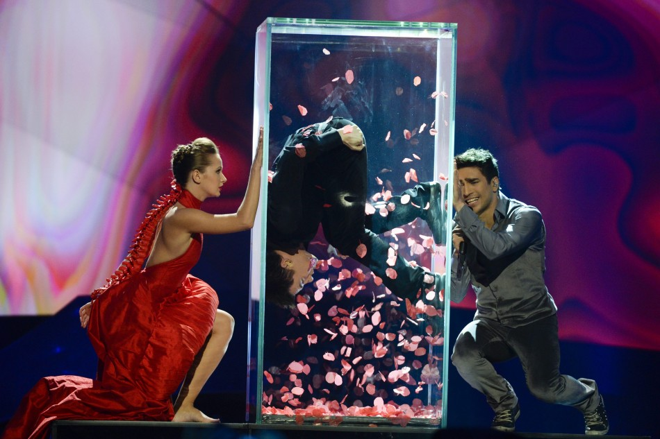 Farid Mammadov R of Azerbaijan performs the song Hold Me during the final of the 2013 Eurovision Song Contest at the Malmo Opera Hall in Malmo May 18, 2013.