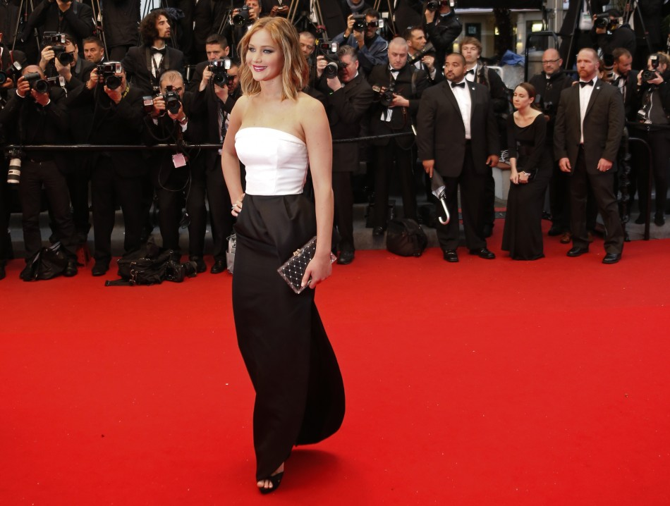 Actress Jennifer Lawrence poses on the red carpet as she arrives for the screening of the film Jimmy P. Psychotherapy of a Plains Indian in competition at the 66th Cannes Film Festival in Cannes May 18, 2013.