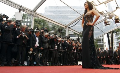 Model Megan Gale poses on the red carpet as she arrives for the screening of the film Jimmy P. Psychotherapy of a Plains Indian in competition at the 66th Cannes Film Festival in Cannes May 18, 2013.