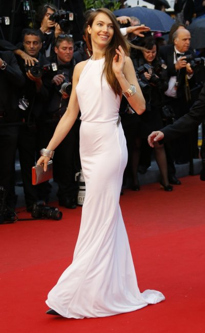 Model Jessica Miller poses on the red carpet as she arrives for the screening of the film Jimmy P. Psychotherapy of a Plains Indian in competition at the 66th Cannes Film Festival in Cannes May 18, 2013.