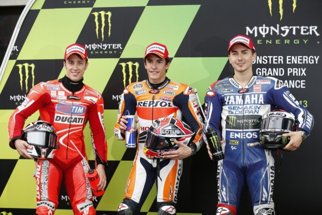 Marquez flanked by Dovizioso (L) and  Lorenzo