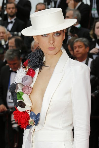 Model and designer Olga Sorokina poses on the red carpet as she arrives for the screening of the film Inside Llewyn Davis in competition during the 66th Cannes Film Festival in Cannes May 19, 2013.